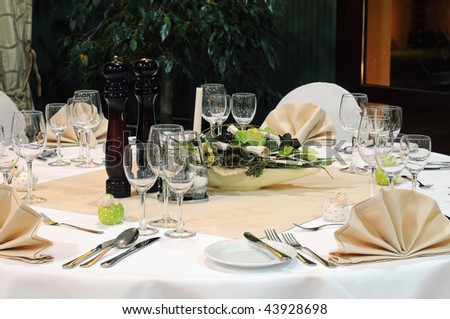 Elegant banquet table prepared for a party. - stock photo