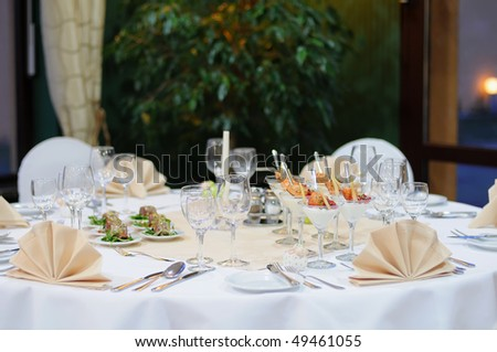 Elegant banquet table prepared for a party - stock photo