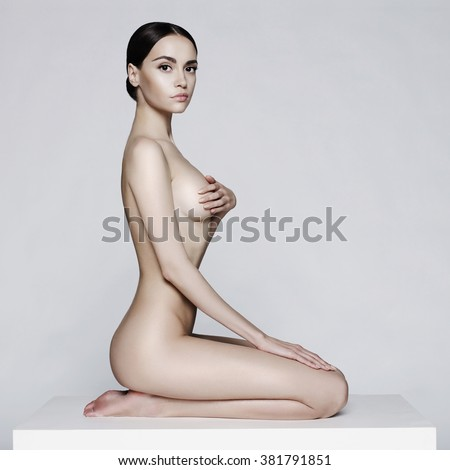 Elegant beautiful sitting lady on white background