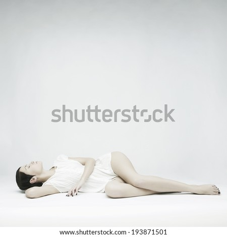 Elegant beautiful sleeping lady on white background - stock photo