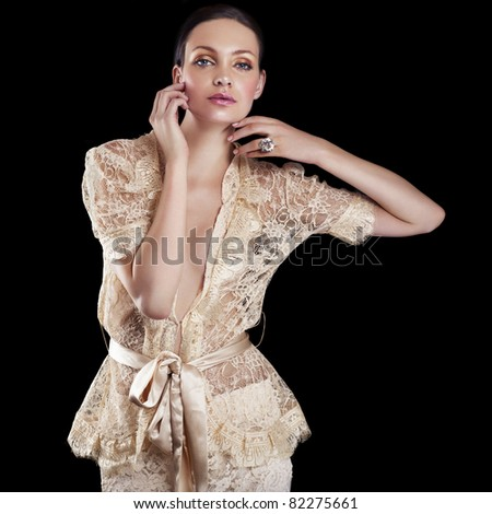 Elegant beautiful woman in lace dress - stock photo