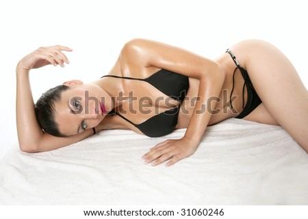 Elegant beautiful woman with black bikini posing at studio - stock photo