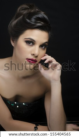 Elegant beautiful woman with salon styled hair and makeup - stock photo