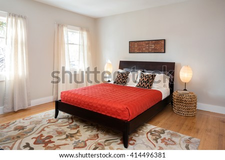 Elegant bedroom with red bed cover.  - stock photo