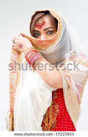 Elegant Bengali bride with veil in front of mouth, isolated - stock photo