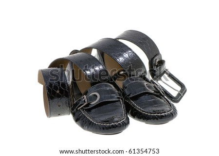 elegant black lady's shoes and belt  over white