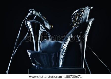 Elegant black patent-leather shoes, on high heels - stock photo