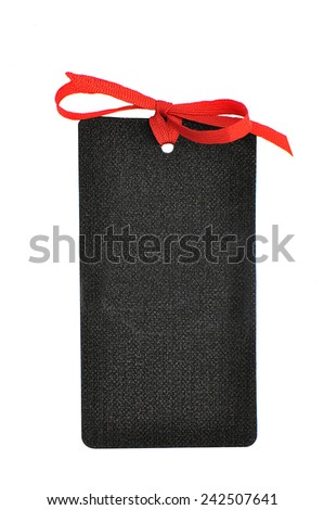 Elegant blank black gift tag with red ribbon bow isolated on white background