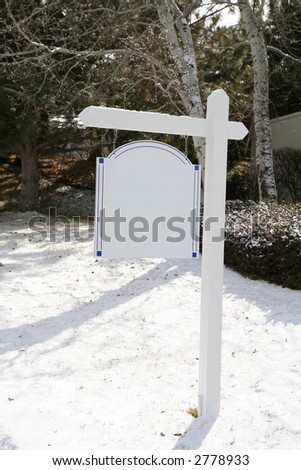 Elegant blank real estate sign in snowy yard - stock photo