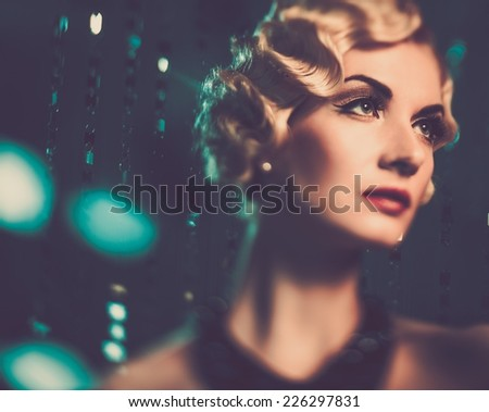 Elegant blond retro woman with beautiful hairdo  - stock photo