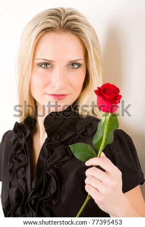 Elegant blond woman hold red rose wear black dress - stock photo