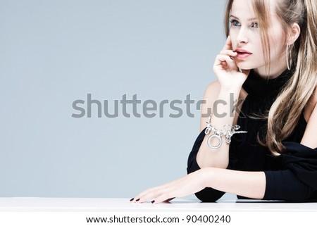 elegant blond woman portrait, studio shot - stock photo