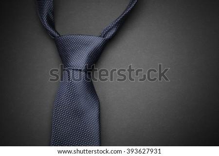 Elegant  blue tie on dark background - stock photo