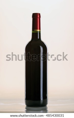 Elegant bottle of red wine in a classic style.