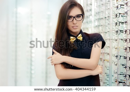 Elegant Bowtie Woman with Cat Eye Frame Glasses in Optical Store - Sophisticated girl wearing eyeglasses in optician shop  - stock photo