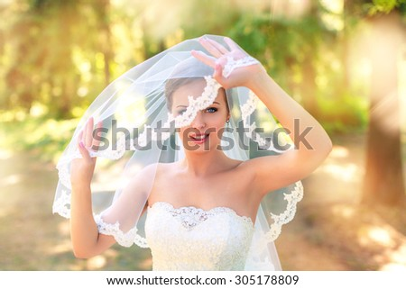 elegant bride in an expensive suit,wedding, the groom's suit, nature, love, wedding dress, bridal bouquet, beautiful couple, summer, celebration, holiday, walk wedding  - stock photo