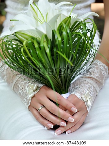 Elegant bride with a bouquet on her wedding day - stock photo