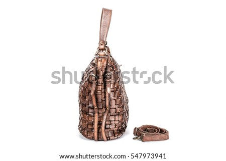 Elegant brown handbag sewn from intertwined leather strips isolated on white background