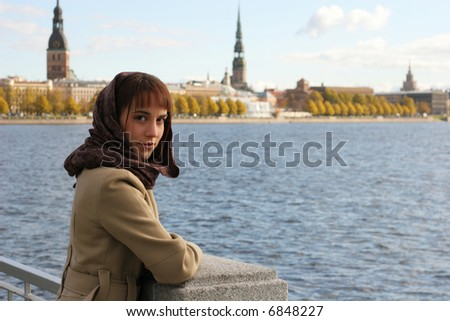 Elegant brunette woman on the riverbank - stock photo