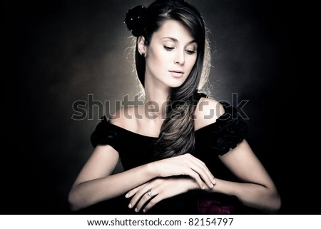 elegant brunette woman portrait, studio shot - stock photo
