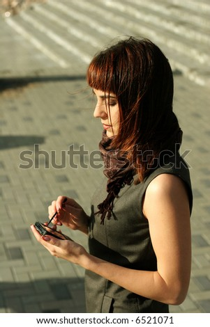 Elegant brunette woman with a PDA - stock photo