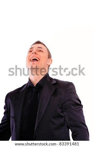 Elegant business man in a suit laughing - isolated over a white background