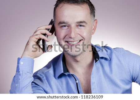 Elegant business man talking on phone.
