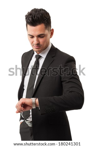 Elegant business man wearing a black suit, checking his watch because its time for making more money new profit