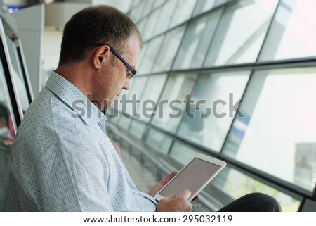 elegant business man with tablet