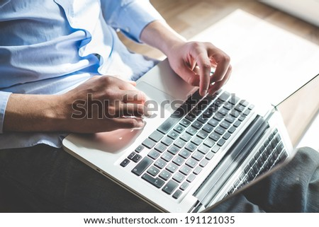 elegant business multitasking multimedia man using devices at home - stock photo
