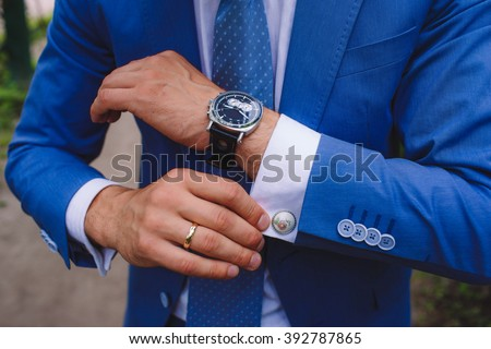 Elegant businessman, male hands corrected cufflinks - stock photo