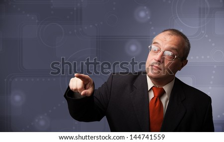 Elegant businessman standing and touching copy space