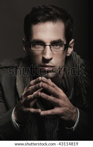Elegant businessman thinking - stock photo