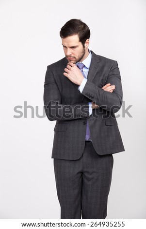 elegant businessman wearing grey suit and tie with beard hands crossed, isolated