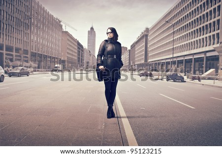 Elegant businesswoman on a city street