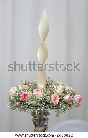 Elegant candlestick decorated with pink mini roses - stock photo