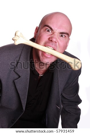 Elegant cannibal men eat bone - stock photo
