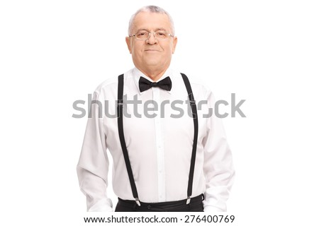 Elegant cheerful senior standing with his hands in his pockets and looking at the camera - stock photo