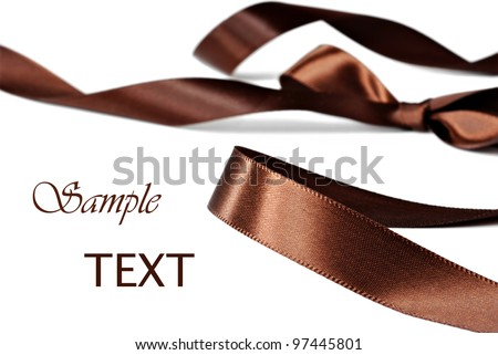 Elegant chocolate brown satin ribbon on white background with copy space.  Macro with extremely shallow dof. - stock photo