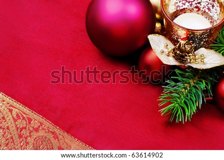 Elegant, Christmas background with candle, baubles, pine branches.