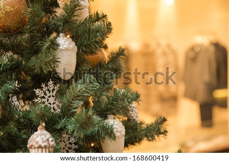 Elegant Christmas tree in a shopping mall - stock photo