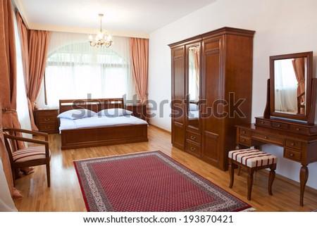 Elegant classic hotel room - stock photo
