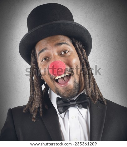 Elegant clown smiles with his red nose