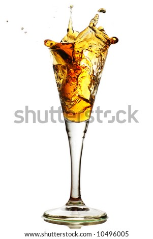 elegant cocktail glass with splash of drink, port, sherry any amber colored liquid - stock photo