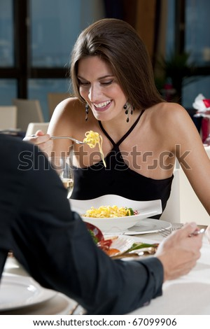 Elegant Couple at The Restaurant - stock photo