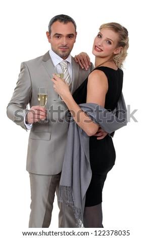 Elegant couple celebrating with champagne - stock photo