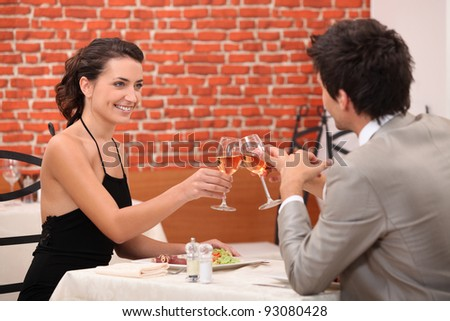 Elegant couple dating in a restaurant - stock photo