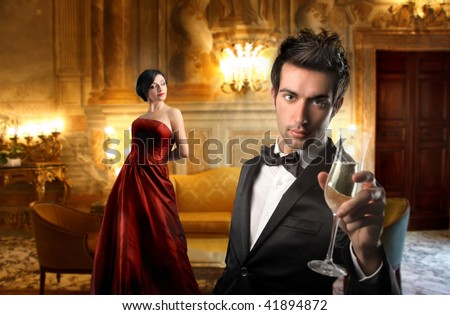 elegant couple drinking wine in a luxury interior - stock photo