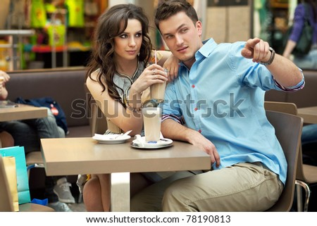 Elegant couple having fun at lunch in shopping mall - stock photo