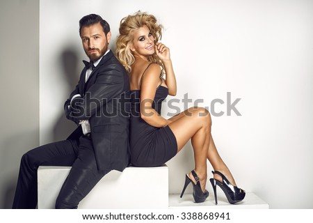 Elegant couple looking at the camera - stock photo